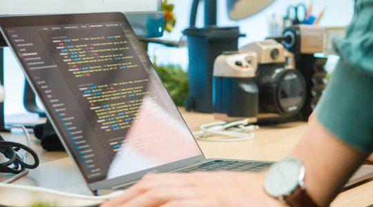 Image of man looking at computer