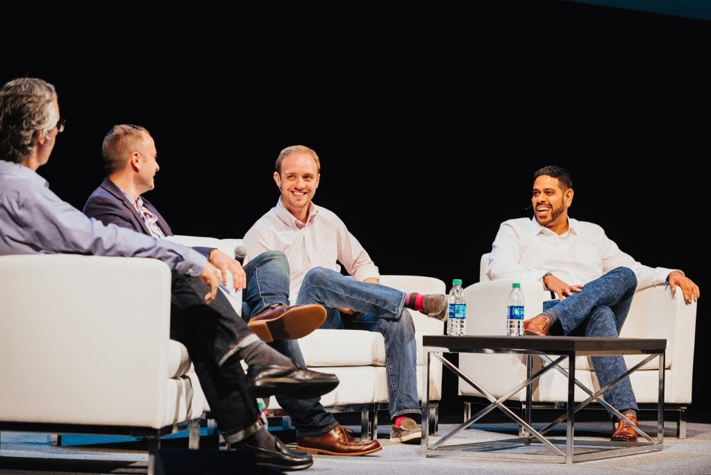 Speakers chat at a fireside talk on stage at Postback 2016
