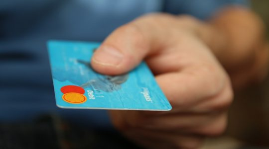 Man holding a credit card in the new era of retail.