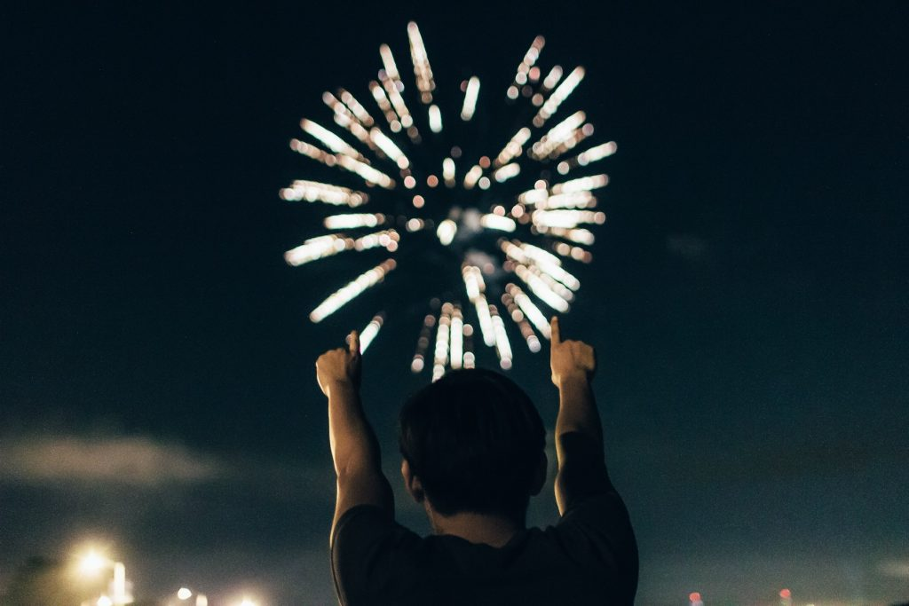 A man watches fireworks and celebrates the new year